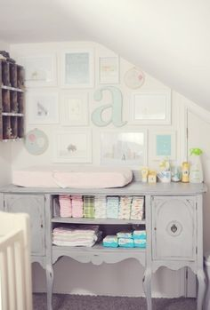 Great antique sideboard repurposed as a changing table!