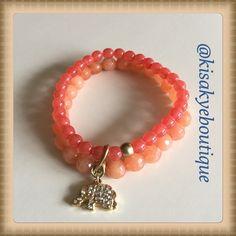 Chico's stretch Bracelet. Chico's orange stretch bracelet with a gold tone elephant. Chico's Jewelry Bracelets