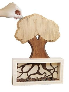 Teds Wood Working Money Tree Coin Bank Woodworking Plan from WOOD Magazine (for purchase) - Get A Lifetime Of Project Ideas & Inspiration! Wood Magazine, Wooden Crafts, Diy Crafts, Money Trees, Diy Holz, Wood Plans, Fine Woodworking, Woodworking Furniture, Woodworking Ideas