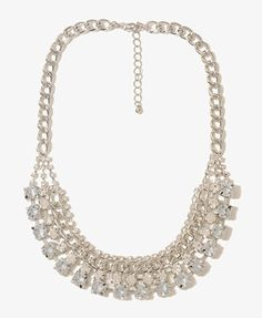 This rhinestone necklace is just like the ones from j.crew for 10x.  Fun under a blue and white striped oxford.    Forever21  9.80