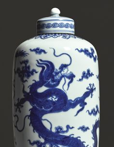 A MAGNIFICENT AND RARE BLUE AND WHITE CYLINDRICAL 'DRAGON' TEA CADDY AND COVER. YONGZHENG MARK AND PERIOD