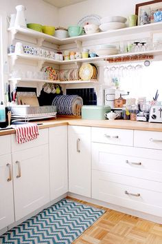 Open kitchen shelves for storage - the home of jewelry designer tamar schechner of Nest Pretty Things