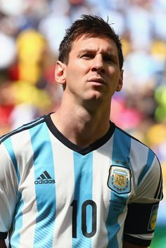 Lionel Messi of Argentina looks on during the National Anthem prior to 2014 FIFA World Cup Brazil Quarter Final match between Argentina and ...