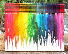 Melted crayon rainbow -- this would be super fun for a kids bedroom or a craft area!
