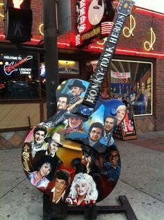 Pose with this guitar in downtown Nashville, Tennessee. I'll be using my pointy finger to highlight some of my favorite singers!  #OneOfAKindNashville