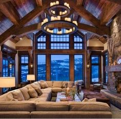 i like the chandelier hanging from vaulted ceiling and windows are beautful  HS: Fixture and big sofa