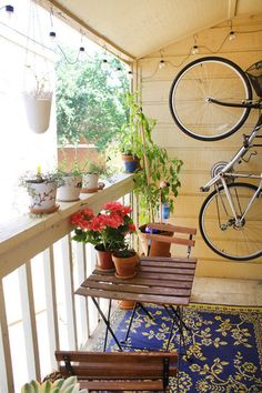 bike on the balcony - great space saving idea!  i was going to leave my bike at my parents but maybe now I'll store it on my new balcony with this solution!  Just wish i could see the hook :(