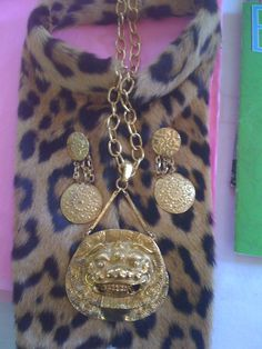 SOLD!   Leopard dickie with vintage goldtone lion pendant necklace. All pieces have been sold