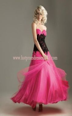 A sweet ball gown with a ruched sweetheart neckline. The fitted bodice has beaded lace overlay for contrasting effect. The full tulle skirt makes this dress fit for a princess. Fabric tulle and lace sizes 0-32. Tags :Long Ball Dress Pink