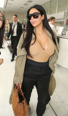 Kim arriving at Nice airport, France - June 23, 2015 not a flattering outfit but Kim is beautiful