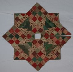 Christmas Patch ... by cmccourtquilts | Quilting Pattern - Looking for your next project? You're going to love Christmas Patch Tree Skirt by designer cmccourtquilts. - via @Craftsy