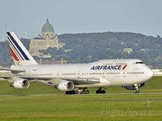 Air France 747 (F-GISC) at Montreal YUL Dorval Airport. L'Oratoire St-Joseph in the background. 2014.