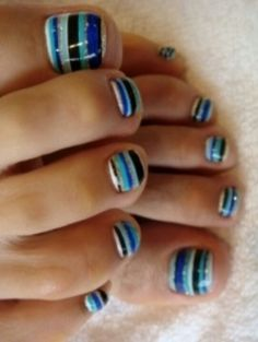 Striped toe nails...I feel like this would take forrrrrevvvverrrrrr to do. But still cute. :)