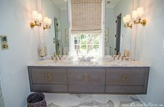 Gray is the new white.  I luv the wall vanity with  the square gold hardware.  Adding the mirror wall to wall gives the illusion that the room is bigger and I am really of fan of mounting the lights on the perpendicular walls....very different and maximizes the space.