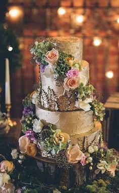 Featured Photographer: Crystal Stokes Photography; Unique gold wedding cake topped with pretty flowers