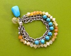 $16.00.  LOVELY!  This three-strand bracelet consists of dull silver tone chain, small cubes of citrine, and round turquoise acrylic beads.  Love this vendor.