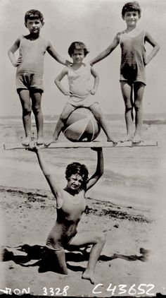 Woman holding up children on the beach, 1931  [::SemAp FB || SemAp G+::]