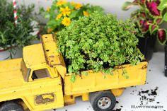 Yellow dump truck planter