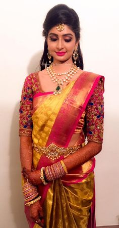 Our bride Aishwarya sets new bridal goals! Makeup and hairstyle by Vejetha for Swank Studio. Pink lips. Bridal jewelry. Bridal hair. Silk sari. Bridal Saree Blouse Design. Indian Bridal Makeup. Indian Bride. Gold Jewellery. Statement Blouse. Tamil bride. Telugu bride. Kannada bride. Hindu bride. Malayalee bride. Find us at https://www.facebook.com/SwankStudioBangalore