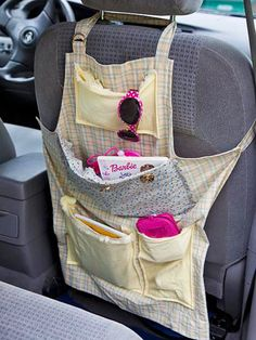 Recycle an old apron into a car organizer! More creative uses for old clothes from @FamilyFun magazine: http://www.parents.com/fun/arts-crafts/kid/get-creative-with-clothes/?socsrc=pmmpin130109cCreativeClothes#page=3