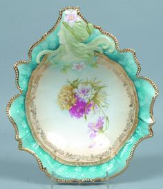 Reinhold Schlegelmilch/RS Prussia bowl, unusual hidden image mold with woman's head, with pointed scalloped rim with blue accent band and ghost flowers Antique Dishes, Vintage Dishes, Antique China, Antique Glass, Vintage China, Porcelain Ceramics, China Porcelain, Painted Porcelain, Vintage Plates