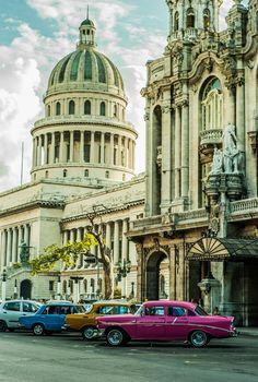 Havana's National Theatre and a sampling of the city's many classic cars.