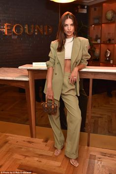 dd876da72a Emily Ratajkowski in tan suit with tiny little satchel handbag. I love this  tiny little