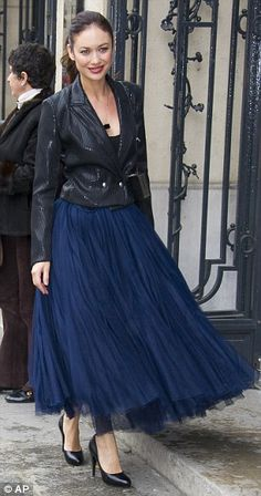 Stylish ladies: Kurylenko looked stunning in a tulle blue dress and cropped black jacket, while Catherine Deneuve was a vision in black