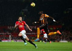 Mohamed Diame of Hull City controls the ball under pressure from Michael Carrick of Manchester United during the Barclays Premier League match between Manchester United and Hull City at Old Trafford on November 29, 2014 in Manchester, England.