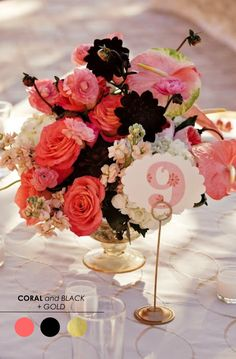 centerpieces - cute and small maybe with the same batch of flowers (different color purples) with a silver urn