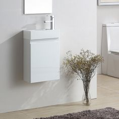 Wall hung bathroom basin sink cabinet vanity unit with a professional high gloss finish. Cloakroom Vanity Unit, Cloakroom Suites, Bathroom Storage Units, Vanity Units, Storage Spaces, Close Coupled Toilets, Basin Sink Bathroom, Wall Hung Vanity, Bath Or Shower