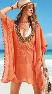 Caftan Dress {Great swim suit cover up}    A sparkling stunner of a cover-up: our chic caftan in light-as-air cotton voile. Dazzling gold embellishment amps up the glam factor of the plunging V-neck while pom-poms flirt along the dramatic kimono sleeves. Slip it on and go from fun in the sun to out at night in an instant.           $69.50