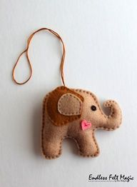 Felt Car mirror ornament - Stuffed Elephant - Christmas tree ornament. $9.00, via Etsy.