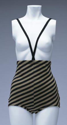 """Monokini"" Swimsuit, Rudi Gernreich for Harmon Knitwear: 1964, striped wool jersey. ""This is the ""monokini,"" a topless bathing suit that shocked the world. This showed the new realization that the skin itself could become a beautiful garment... In 1964 he introduced a topless bathing suit, which he named the ""monokini,"" in contrast to the ""bikini,"" the two-piece swimming suit in fashion in those days. He introduced the thin skin-colored nylon brassiere known as the ""No-Bra"" in 1965..."""