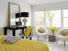 Awesome room! Neutrals + bright yellow, modern shapes, interesting textures, lots of light, and still comes off with a minimalist style.