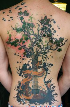 The tree sprouting from the guitar represents the idea that music is so important to life, almost paramount.