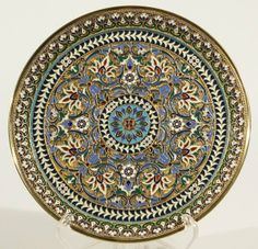 OVCHINNIKOV ANTIQUE RUSSIAN SILVER GILT AND   CLOISONNE ENAMEL PLATE . BY OVCHINNIKOV, MOSCOW, CIRCA 1880'S. oRNATELY DECORATED WITH CONCENTRIC BANDS OF ORNATE FLORAL AND FOLIATE DECORATION ON THE CAAVETTO AND RIM IN POLYCHROME ENAMEL.