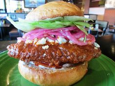 This Bleu Devil will get you movin'! Buttermilk fried chicken breast is tossed in Diablo sauce, and served on a toasted sesame bun with bleu cheese crumbles, bleu cheese dressing, tomato, lettuce, pickled onions, and yes…hand-wipes. #SPORT #Seattle #Sandwich