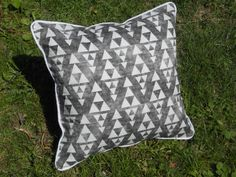 A personal favorite from my Etsy shop https://www.etsy.com/listing/235920754/triangle-pillow-white-and-black