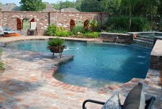 The Pool Guy LA classic designed inground swimming pool photos.See some of Lafayette, La classic swimming pool and spa photos.