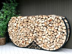 Prepare for the colder months with these chic and clever firewood storage ideas.