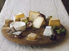 the perfect cheese platter: raw honey comb, olives, figs, 6 types of artisnal cheeses, and crackers