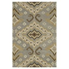 Wool rug with an ikat-inspired motif. Hand-tufted in India.  Product: RugConstruction Material: 100% Wool