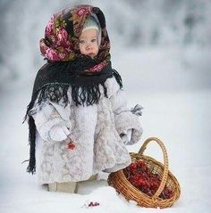 Little Russian girl with rowanberries