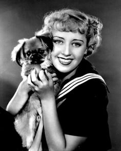 Artists & Animals #86: Joan Blondell cuddles a Pekingese pup.   I loved her in the TV series when she was older, the series HERE COMES THE BRIDES, set in Seattle.