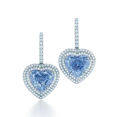 This exceptionally rare pair of heart-shaped Fancy Vivid blue diamond earrings from Tiffany & Co. are set in platinum and surrounded by round brilliant white diamonds. Colored Diamonds, Blue Diamonds, Heart Earrings, Diamond Earrings, Diamond Jewelry, Fancy Earrings, Stud Earrings, Diamond Pendant, Tiffany Jewelry