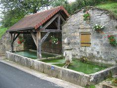 Village fountain and lavoir (washing basin) in Saint-Lothain (Jura), France