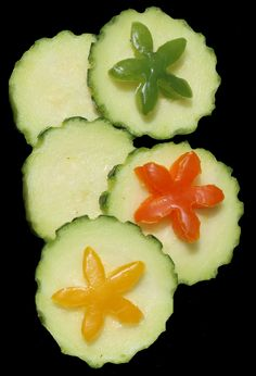 Garnish: Cucumbers with multi-color Pepper Flowers
