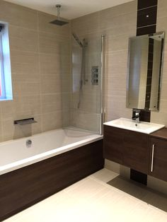 Master Bathroom with waterfall bath / basin taps & a rain shower.