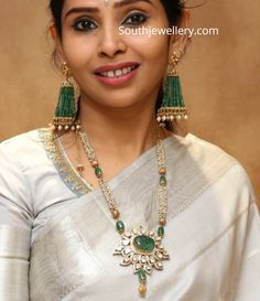 Pearl long necklace with polki pendant and emerald tassel earrings photo Indian Jewelry Earrings, Indian Jewelry Sets, Jewelry Design Earrings, Indian Wedding Jewelry, Indian Jewellery Design, Bead Jewellery, Pearl Jewelry, Gold Jewelry, Tassel Earrings